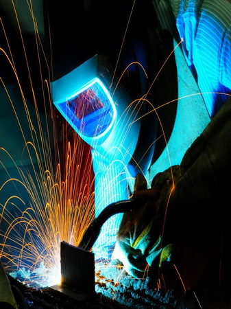 man-welding-and-sparks-flying